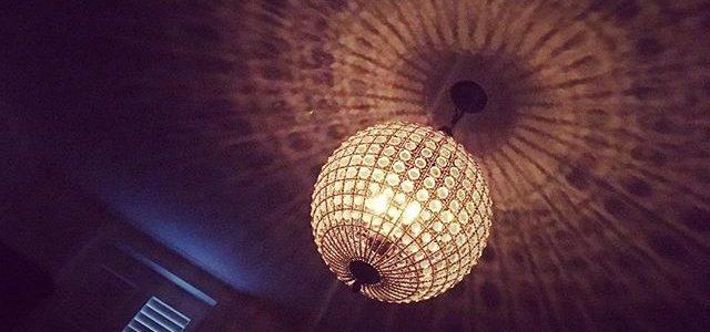 #chandelier #bedroomdecor #interiordesign #deco #decor #window #shutters #night #glamour #shadows #noir #film #location #womeninfilm #productiondesign #light #dark #lust #atmosphere #touchofblue #crystals #glass #globe #sphere